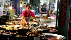 Thai curries dishes Bangkok woman ladles food Stock Footage
