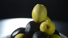 Olives fruit green and black gyrating on black background - stock footage