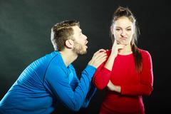 Regretful man husband apologizing woman wife. Stock Photos