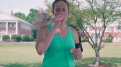Female Runner with Ashtma Using Inhaler - stock footage