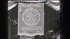 1937: Welcome Legionnaires American Legion street banner veterans of Stock Footage