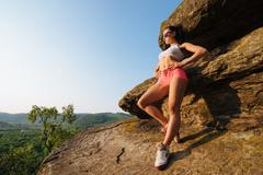 Full length portrait of a young athletic female with perfect figure dressed in Stock Photos