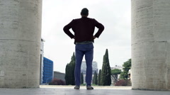 Young man admire Italian cityscape in Rome, Italy Stock Footage