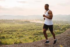 Sexy black african american muscular male model bodybuilder jogging outdoor Stock Photos