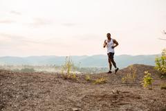 Handsome black african american muscular male model bodybuilder jogging outdoor Stock Photos