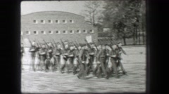 1937: Young army men marching training carry rifle guns in tight formation. Stock Footage