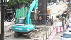 Under construction of new BTS green line on Phahonyothin road in Bangkok - stock footage