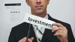 Businessman Cuts Investment Concept Stock Footage