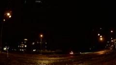 POV dashcam driving on dark rainy night in lightning storm Stock Footage