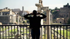 Woman stretching arms and admire view of the Roman Forum from balcony in Rome Stock Footage