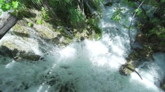 Luxuriant mountain waterfall in slow motion Stock Footage