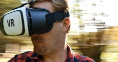 Conceptual virtual reality goggles man looks around the VR 360 world - stock footage