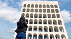 Young woman taking photo of ancient building with cellphone in Rome, Italy Stock Footage