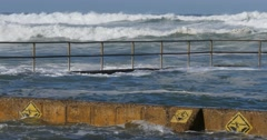 Ocean pool during big waves brought on by stormy cyclone hurricane weather - stock footage