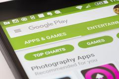 Browsing the Google Play Store on Android smartphone - stock photo