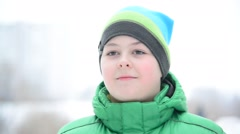 12 year-old boy outside in winter Stock Footage