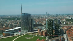 Milan, Italy – May 2016: Unicredit tower and vertical forest skyscraper Stock Footage