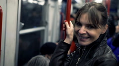 Portrait of happy, pretty woman riding metro  Stock Footage