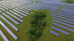Aerial Fly Over Solar Power Panels Field Green Energy Clean Energy Production - stock footage