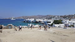Mykonos, Greece – summer 2015. Tourists at the windmills gazing Little Venice. - stock footage