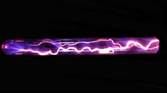 Xenon gas discharges in electromagnetic field that ionized the gas Stock Footage