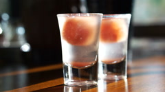 Plum cocktail chilled drink shot - stock footage