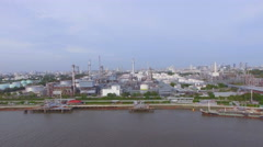 Aerial top view of Oil refinery or factory and container transportation ship Stock Footage