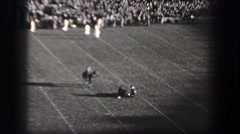 1937: Harvard University football game pranksters fireworks smoke bomb on field. - stock footage