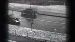1937: Harvard University buildings snowy day car traffic on North Bridge.  Stock Footage