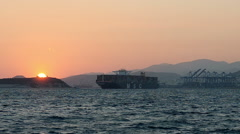 Loaded Container Cargo Ship Leaves the Port at Sunset Stock Footage