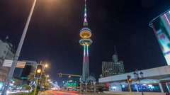 The Liberation Tower timelapse hyperlapse in Kuwait City illuminated at night Stock Footage