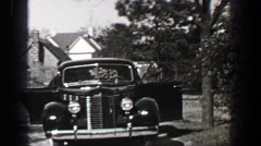 1939: Pontiac 4 door sedan car backing out of driveway front hinged rear door Stock Footage