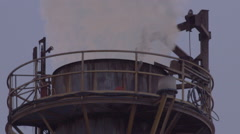 Close up of industrial chimney expelling pollution - stock footage