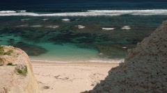 Ocean view from a cliff, secluded white beach Stock Footage