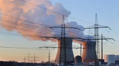 Time lapse of nuclear power station with steam at sunset to night Stock Footage