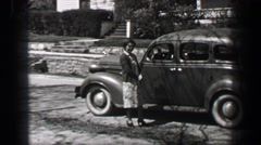 1939: Friendly neighbor southern hospitality woman chatting up car driver Stock Footage