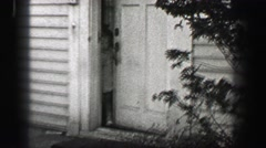 1939: Young girl opens front door runs carelessly towards street escape. ATHENS, Stock Footage