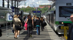 Many passengers and train  at the railway station in Helsinki, Finland. Stock Footage
