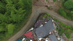 Aerial Footage Looking Down On Destroyed Houses After Kumamoto Earthquake Stock Footage