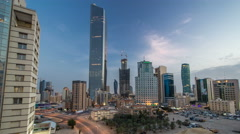 Skyline with Skyscrapers day to night timelapse in Kuwait City downtown Stock Footage