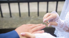 Groom wears on the bride's finger a ring Stock Footage