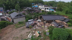 Flying Low Over Destroyed Houses After Powerful Earthquake In Japan Stock Footage