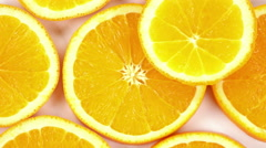 Sliced orange background close-up rotation. Stock Footage