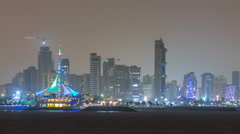 Skyline with Skyscrapers night timelapse in Kuwait City downtown illuminated at - stock footage
