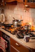 pan boiling on burning gas stove on country style kitchen - stock photo