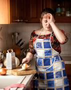 Housewife crying while cutting onion Stock Photos