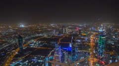 Skyline with Skyscrapers night timelapse in Kuwait City downtown illuminated at Stock Footage