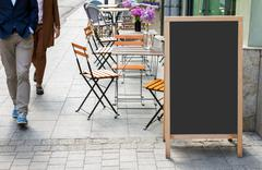 Blank menu blackboard on the street - stock photo