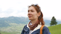 4K. Girl tourist  on vacation speaks by  mobile phone in mountain hills. Close  - stock footage