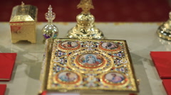 Holy Gospel Bible Book on a table in church - dolly shot Stock Footage